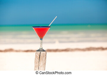 Strawberry margarita on the sandy white beach
