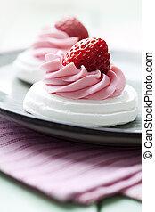 meringue nests with strawberry cream and fresh strawberries