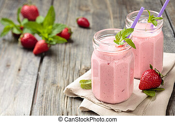 Strawberry milkshake. - Fruit smoothie with mint leaves on...