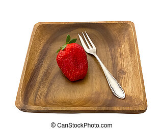 Strawberry on a wooden plate