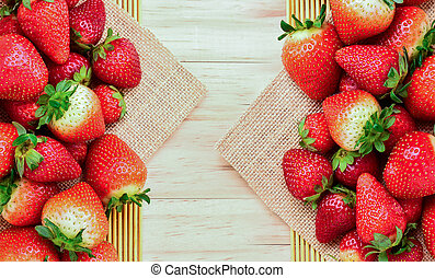 Strawberry on wooden background, top view