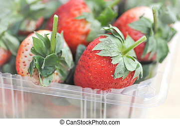 strawberry in the plastic box