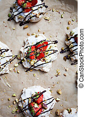 Homemade strawberry pavlova with chocolate and pistachios
