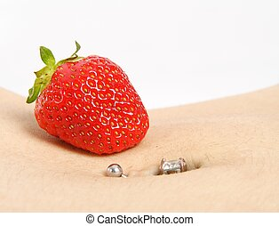 Strawberry Piercing - Closeup of a belly button piercing...