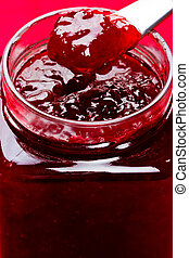 Strawberry preserve on a spoon. - Close up of thick sweet...