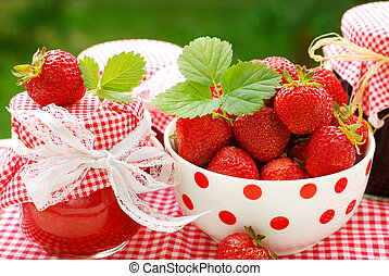 strawberry preserves and bowl of fresh fruits - strawberry...