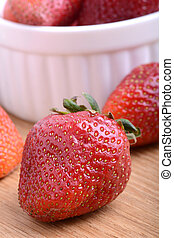 Strawberry set on wooden plate close up