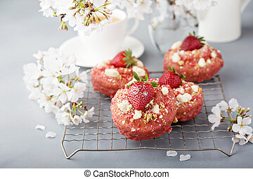 Strawberry shortcake donuts on a cooling rack