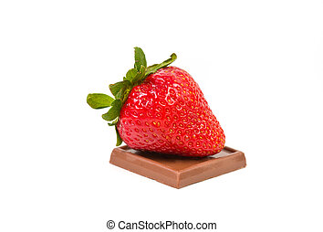 Strawberry sitting on a piece of milk chocolate isolated on a white background