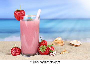 Strawberry smoothie fruit juice with strawberries fruits on the beach