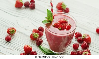 Strawberry smoothie in glass with mint - Served glass with...