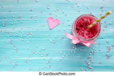 Strawberry smoothie on blue background