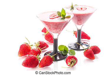strawberry smoothie with mint in glasses on a white...