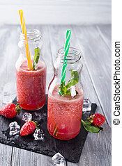 Strawberry smoothies in bottles