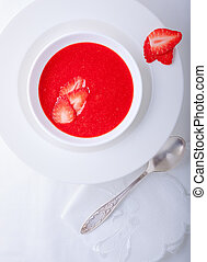 Strawberry soup served on a white plate