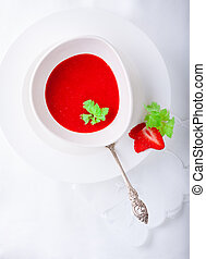 Strawberry soup with white napkin on a table.