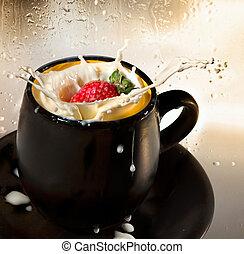 Strawberry splash of milk in a cup.