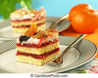 Strawberry sponge cake with dried fruits and nuts