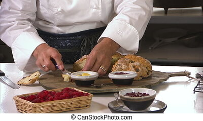 Strawberry spread and raisin bread - A medium shot of a...