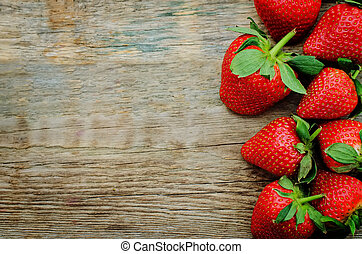 strawberry on dark wood background. tinting. selective focus