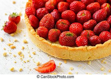Strawberry tart on white wooden background