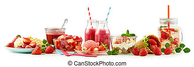Strawberry themed panorama food still life with assorted recipes including waffle and cream, ice cream, fruit salad, muesli and yogurt, whole ripe berries and infused water over white