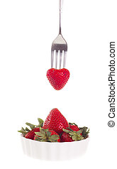strawberry with fork, isolated on white