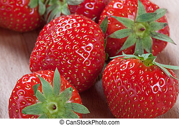 Strawberry with green leaf