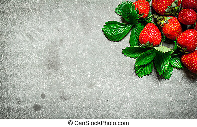 Strawberry with green leaves.