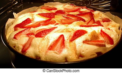 Strawberry yeast-cake baking in oven