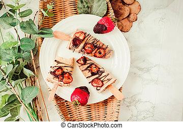 Strawberry yogurt ice cream popsicles ,Summer dessert with chocolate..Top view.