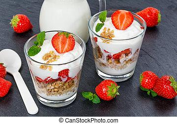 Strawberry yogurt yoghurt strawberries fruits cup muesli slate spoon breakfast
