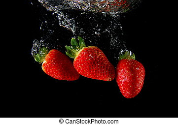 healthy lifestyle - strawberrys splashing in fresh water ...