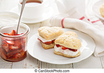Strawbery shortcakes with whipped cream and fresh berries