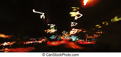 Abstract colorful streaks of light from city traffic, suggesting speed