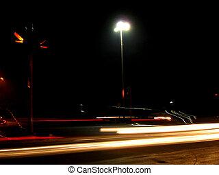 Streaks of light of passing vehicles