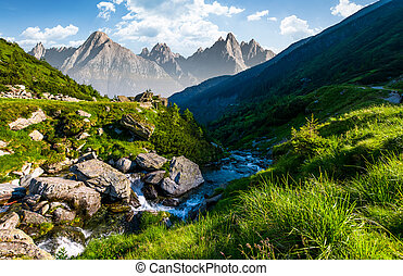 stream among the rocks in grassy valley. gorgeous summertime...