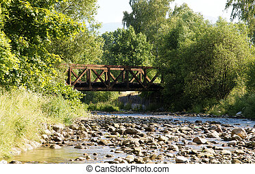 Landscape with Stream and old rusted ralway bridge.