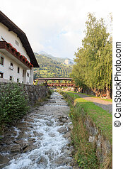 Stream Bretterwandbach with bridge in Matrei in Osttirol, Austria