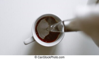 Stream hot water flow pour into instant black coffee - Top...