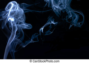 Stream of a blue smoke on a black background