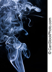 Stream of a blue smoke on a black background