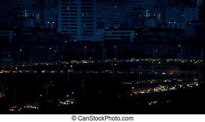 Stream Of Cars Lighting Up City Roads At Night - Night...