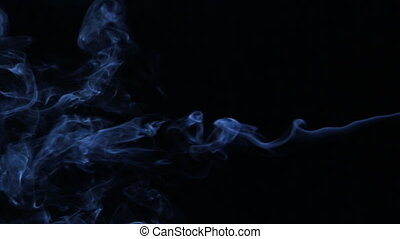 Stream of smoke passes into the clubs, swirls of smoke. Abstract background.