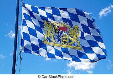 Streaming Bavarian flag against blue sky