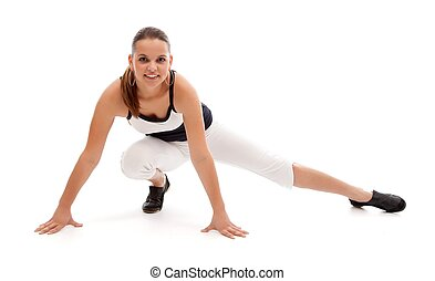 Fitness woman doing streching after the aerobic class