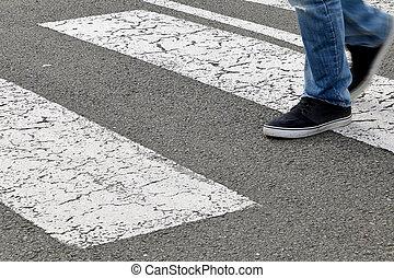 Street - a man crossing a crosswalk