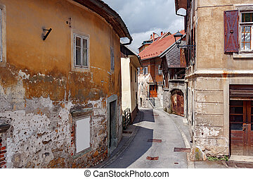 Street A small town in the mountains of Slovenia, Europe. Shabby old houses facades, and roofs