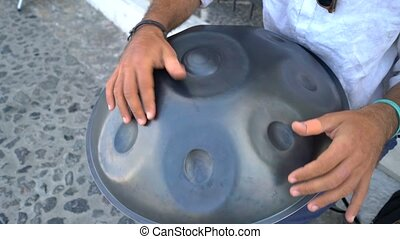 Street Artist Performing On The Street With Handpan.