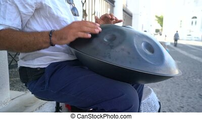 Street Artist Performing On The Street With Handpan. Hands Close Up.